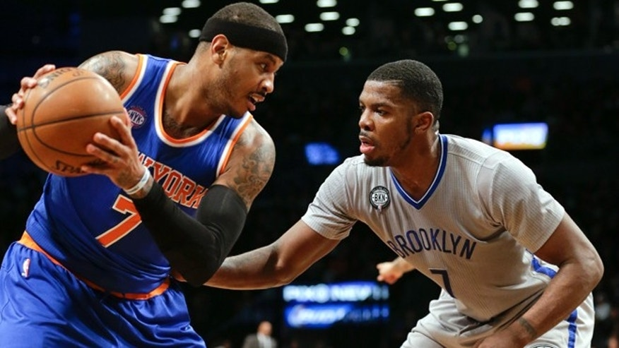Brooklyn Nets' Joe Johnson and Carmelo Anthony during an NBA game Friday, Feb. 6, 2015, in New York.