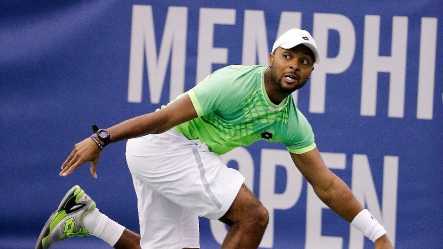 Donald Young returns a shot to Bernard Tomic in a quarterfinal round tennis match at the Memphis Open Friday, Feb. 13, 2015, in Memphis, Tenn. (AP Photo/Mark Humphrey)