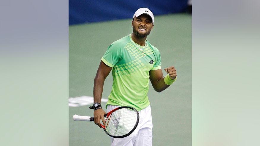 Donald Young celebrates after beating Bernard Tomic in a quarterfinal round tennis match at the Memphis Open, Friday, Feb. 13, 2015, in Memphis, Tenn. Young won the match 7-6 (8), 4-6, 7-5. (AP Photo/Mark Humphrey)
