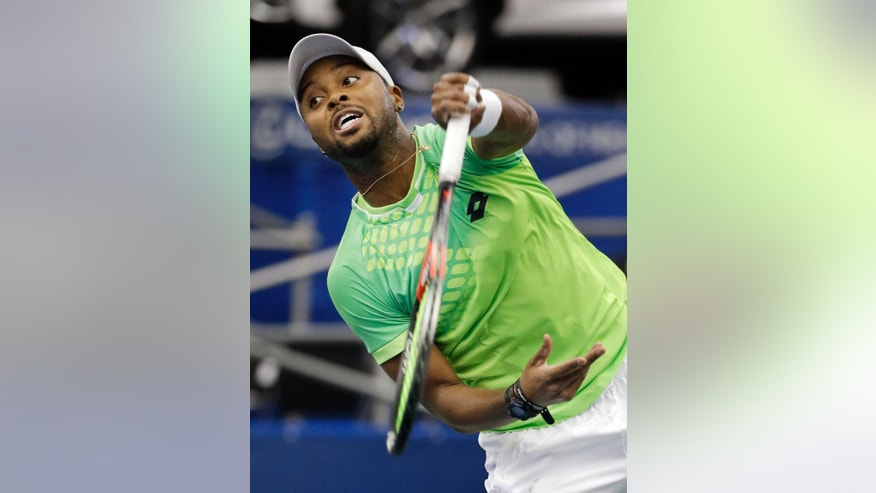 Donald Young serves to Bernard Tomic in a quarterfinal round tennis match at the Memphis Open Friday, Feb. 13, 2015, in Memphis, Tenn. (AP Photo/Mark Humphrey)