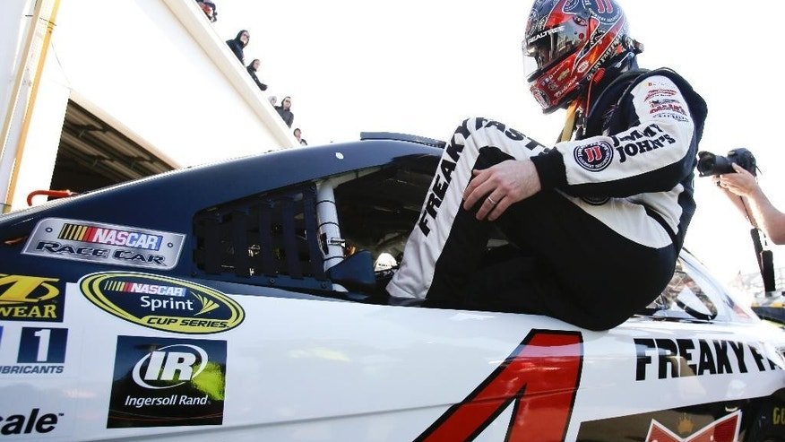 Kevin Harvick climbs in his car during practice for the NASCAR Sprint Cup Series auto race at Daytona International Speedway, Friday, Feb. 13, 2015, in Daytona Beach, Fla. (AP Photo/John Raoux)