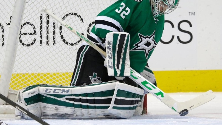 Dallas Stars goalie Kari Lehtonen (32) blocks a shot during the first period of an NHL hockey game against the Florida Panthers on Friday, Feb. 13, 2015, in Dallas. (AP Photo/LM Otero)