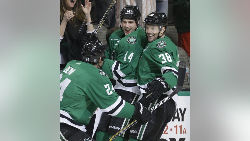 Dallas Stars left wing Jamie Benn (14) celebrates his goal with center Vernon Fiddler (38) and left wing Jamie Benn (14) during the first period of an NHL hockey game against the Florida Panthers on Friday, Feb. 13, 2015, in Dallas. (AP Photo/LM Otero)
