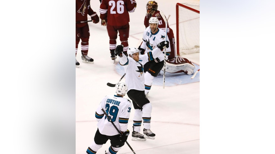 San Jose Sharks' Joe Pavelski (8) celebrate his goal with teammates Joe Thornton (19) and Logan Couture (39) during the second period of an NHL hockey game against the Arizona Coyotes, Friday, Feb. 13, 2015, in Glendale, Ariz. (AP Photo/Matt York)