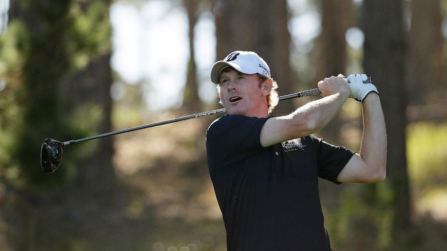 Brandt Snedeker follows his drive from the 11th tee of the Spyglass Hill Golf Course during the second round of the AT&T Pebble Beach National Pro-Am golf tournament Friday, Feb. 13, 2015, in Pebble Beach, Calif. (AP Photo/Eric Risberg)