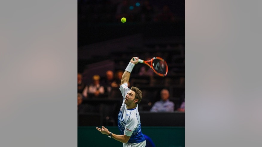 Stan Wawrinka of Switzerland rserves the ball to Milos Raonic of Canada during their semifinal match of the 42nd ABN AMRO world tennis tournament at Ahoy Arena in Rotterdam, Netherlands, Saturday, Feb. 14, 2015. (AP Photo/Patrick Post)