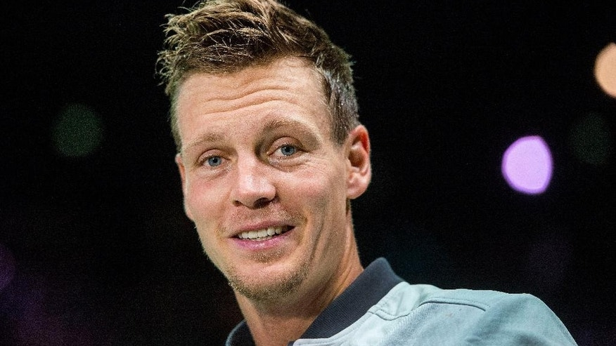 Thomas Berdych of the Czech Republic smiles after winning the semifinal match against Gilles Simon of France during the 42nd ABN AMRO world tennis tournament at Ahoy Arena in Rotterdam, Netherlands, Saturday, Feb. 14, 2015. (AP Photo/Patrick Post)