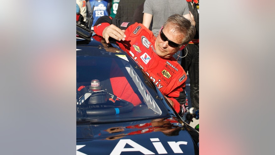 Pole sitter Mark Thompson climbs in his car before the start of the ARCA series auto race at Daytona International Speedway, Saturday, Feb. 14, 2015, in Daytona Beach, Fla. At 63 years of age, Thompson is the oldest pole winner in a major race at Daytona International Speedway. (AP Photo/Terry Renna)