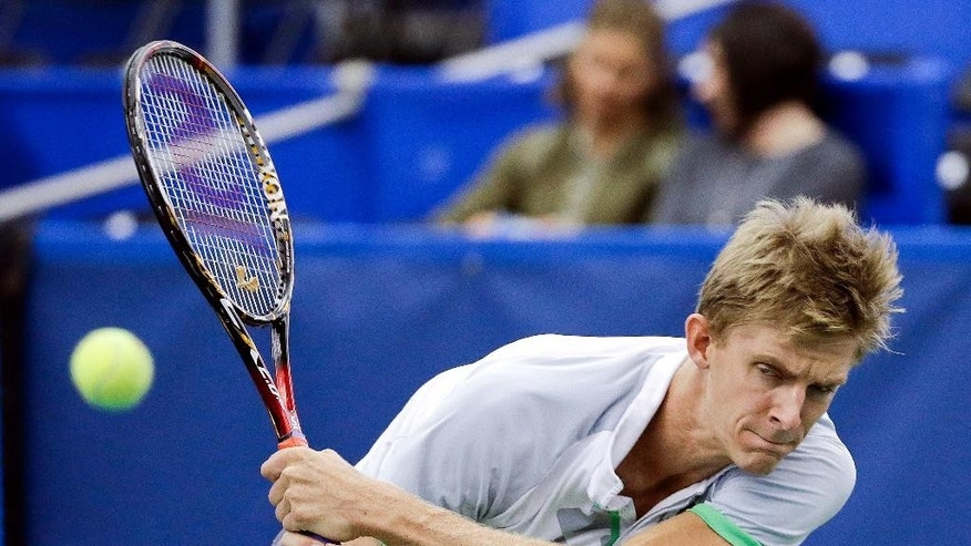 Kevin Anderson, of South Africa, returns a shot to Donald Young in a semifinal round tennis match at the Memphis Open, Saturday, Feb. 14, 2015, in Memphis, Tenn. (AP Photo/Mark Humphrey)