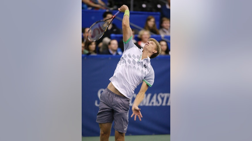 Kevin Anderson, of South Africa, serves to Donald Young in a semifinal round tennis match at the Memphis Open, Saturday, Feb. 14, 2015, in Memphis, Tenn. (AP Photo/Mark Humphrey)