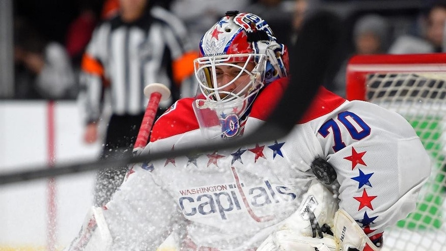 Washington Capitals goalie Braden Holtby stops a shot during the second period of an NHL hockey game against the Los Angeles Kings, Saturday, Feb. 14, 2015, in Los Angeles. (AP Photo/Mark J. Terrill)