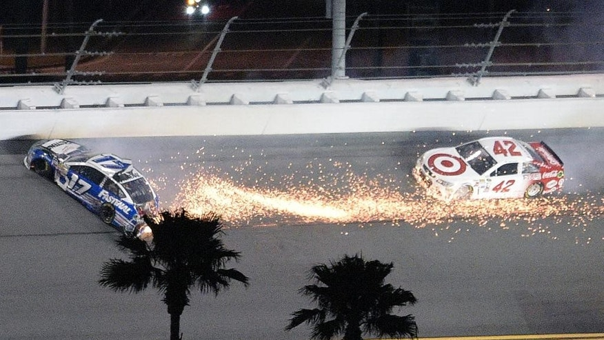 Ricky Stenhouse Jr. (17) slides on the track after being involved in a collision as Kyle Larson (42) follows during the NASCAR Sprint Unlimited auto race at Daytona International Speedway, Saturday, Feb. 14, 2015, in Daytona Beach, Fla. (AP Photo/Phelan M. Ebenhack)