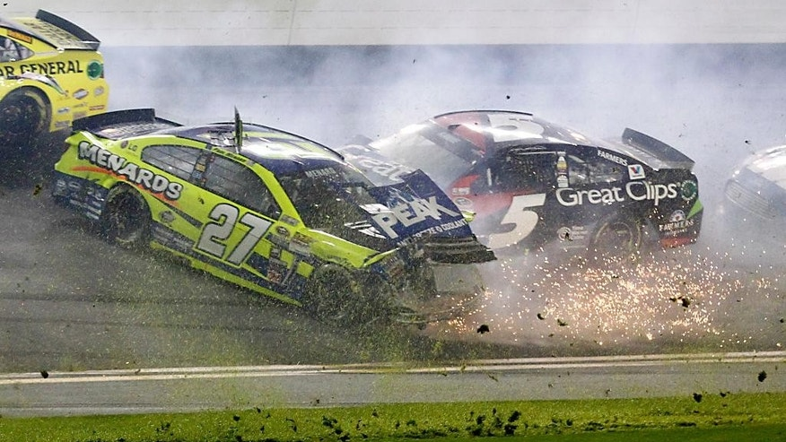 Kasey Kahne (5) crashes into Paul Menard (27) during a multi-car crash in the NASCAR Sprint Unlimited auto race at Daytona International Speedway, Saturday, Feb. 14, 2015, in Daytona Beach, Fla. (AP Photo/Terry Renna)