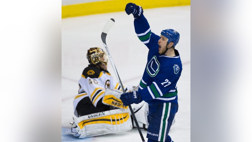 Vancouver Canucks' Shawn Matthias, right, celebrates his third goal of the night against Boston Bruins goalie Tuukka Rask, of Finland, during the third period of an NHL hockey game Friday, Feb. 13, 2015, in Vancouver, British Columbia. (AP Photo/The Canadian Press, Darryl Dyck)
