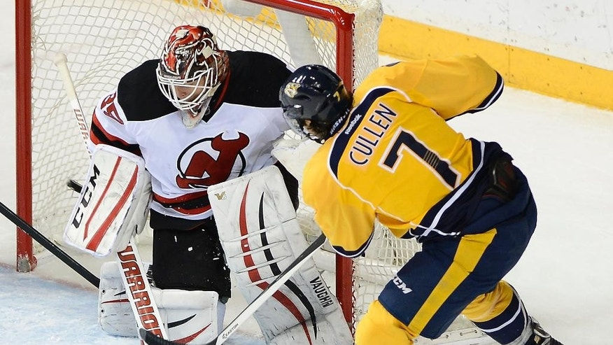 Nashville Predators center Matt Cullen (7) scores a goal against New Jersey Devils goalie Cory Schneider (35) in the first period of an NHL hockey game, Saturday, Feb. 14, 2015, in Nashville, Tenn. (AP Photo/Mark Zaleski)