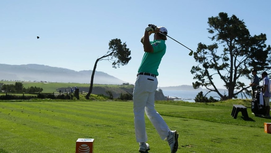 Brandt Snedeker hits from the fifth tee of the Pebble Beach Golf Links during the final round of the AT&T Pebble Beach National Pro-Am golf tournament Sunday, Feb. 15, 2015, in Pebble Beach, Calif. (AP Photo/Eric Risberg)