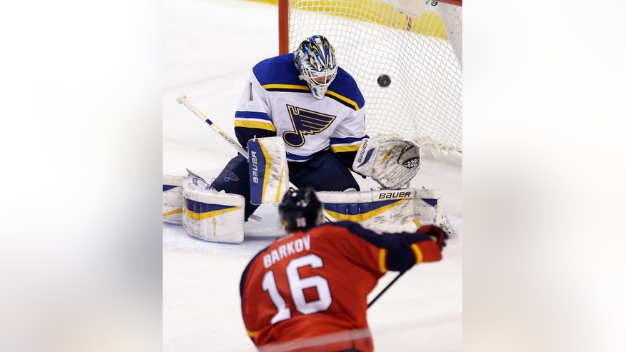 St. Louis Blues goalie Brian Elliott (1) blocks a shot by Florida Panthers center Aleksander Barkov (16) during the second period of an NHL hockey game in Sunrise, Fla., Sunday, Feb. 15, 2015. (AP Photo/Alan Diaz)
