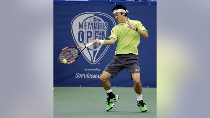 Kei Nishikori, of Japan, returns a shot to Kevin Anderson, of South Africa, in the championship match of the Memphis Open tennis tournament Sunday, Feb. 15, 2015, in Memphis, Tenn. (AP Photo/Mark Humphrey)