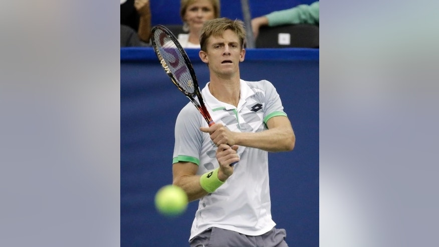 Kevin Anderson, of South Africa, returns a shot to Kei Nishikori, of Japan, in the championship match of the Memphis Open tennis tournament Sunday, Feb. 15, 2015, in Memphis, Tenn. (AP Photo/Mark Humphrey)