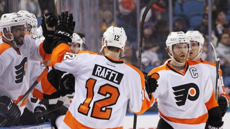 Philadelphia Flyers' Michael Raffl (12), of Austria, celebrates his goal against the Buffalo Sabres with teammates along the bench during the third period of an NHL hockey game Sunday, Feb. 15, 2015, in Buffalo, N.Y. Philadelphia defeated Buffalo 2-1. (AP Photo/Jen Fuller)