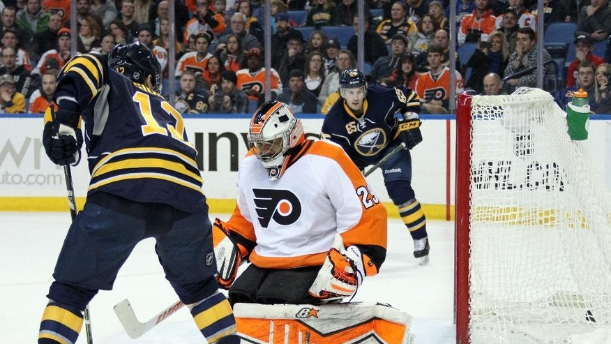 Buffalo Sabres Brian Gionta, left, looks for a rebound as teammate Nikita Zadorov (not pictured), of Russia, scores a goal against Philadelphia Flyers' Ray Emery (29) during the second period of an NHL hockey game, Sunday, Feb. 15, 2015, in Buffalo, N.Y. (AP Photo/Jen Fuller)