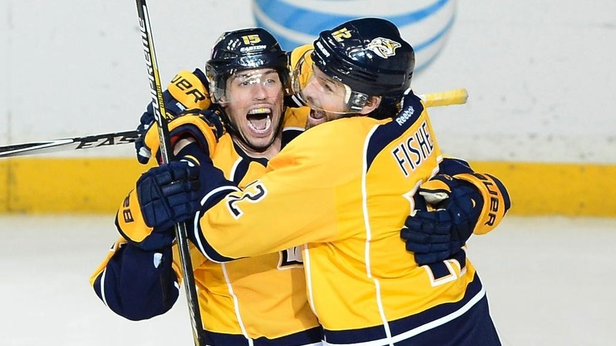 Nashville Predators center Craig Smith, left, celebrates with forward Mike Fisher (12) after Smith scored a goal in the third period of an NHL hockey game against the New Jersey Devils, Saturday, Feb. 14, 2015, in Nashville, Tenn. The Predators won 3-1. (AP Photo/Mark Zaleski)