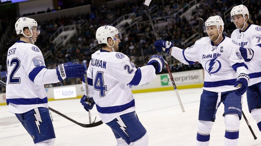 Tampa Bay Lightning's Ryan Callahan, second from left, celebrates his goal with teammates during the second period of an NHL hockey game against the San Jose Sharks Sunday, Feb. 15, 2015, in San Jose, Calif. (AP Photo/Marcio Jose Sanchez)