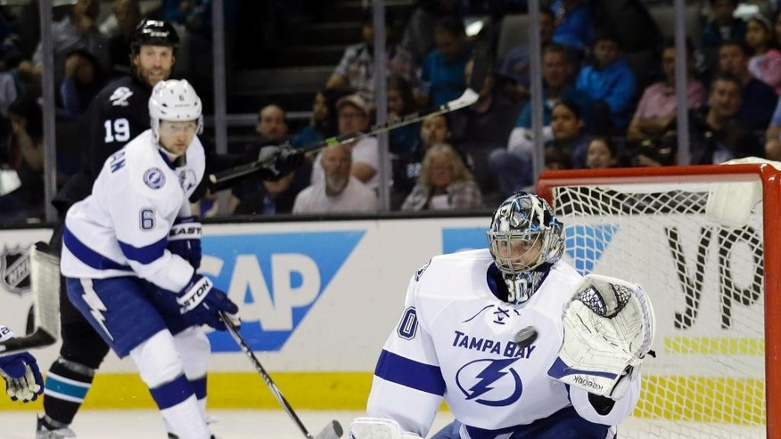 Tampa Bay Lightning goalie Ben Bishop stops a shot by the San Jose Sharks during the first period of an NHL hockey game Sunday, Feb. 15, 2015, in San Jose, Calif. (AP Photo/Marcio Jose Sanchez)