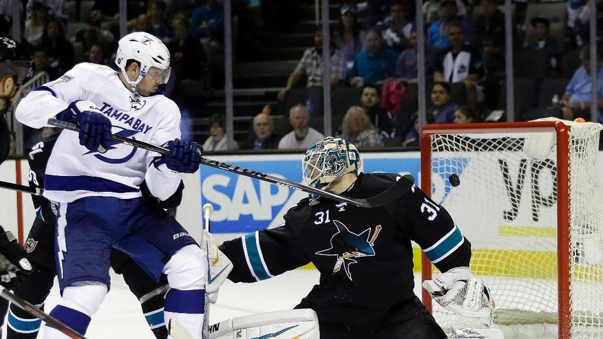 San Jose Sharks goalie Antti Niemi, right, is beaten for a goal on a shot by Tampa Bay Lightning's Ryan Callahan, not seen, next to Lightning center Alex Killorn, left, during the second period of an NHL hockey game Sunday, Feb. 15, 2015, in San Jose, Calif. (AP Photo/Marcio Jose Sanchez)