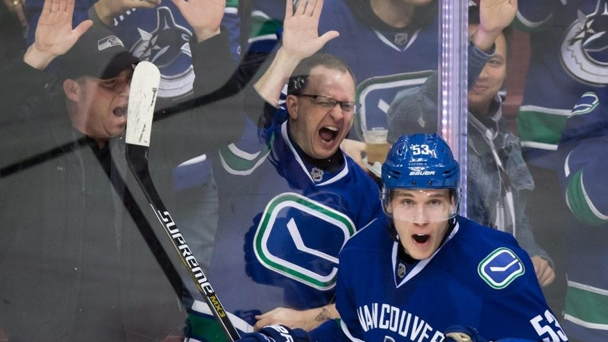 Vancouver Canucks' Bo Horvat celebrates his goal against the Minnesota Wild during the third period of an NHL hockey game against the Minnesota Wild in Vancouver, British Columbia,  Monday, Feb. 16, 2015. (AP Photo/The Canadian Press, Darryl Dyck)