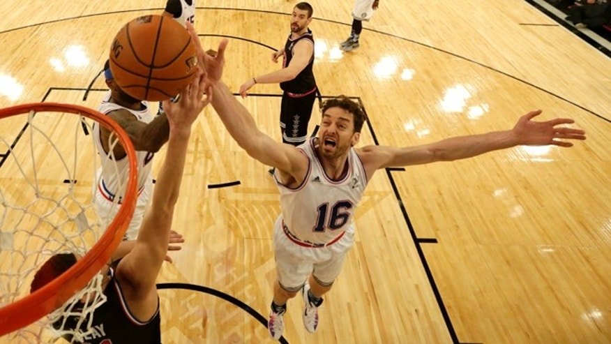 East Teamâs Pau Gasol, right, of the Chicago Bulls, goes up for the rebound during the second half of the NBA All-Star basketball game, Sunday, Feb. 15, 2015, in New York. (AP Photo/Jason Szenes, Pool)