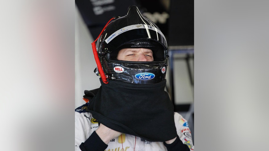 Brad Keselowski adjusts his helmet before getting in his car during a practice session for the Daytona 500 NASCAR Sprint Cup Series auto race at Daytona International Speedway, Saturday, Feb. 14, 2015, in Daytona Beach, Fla. (AP Photo/Terry Renna)