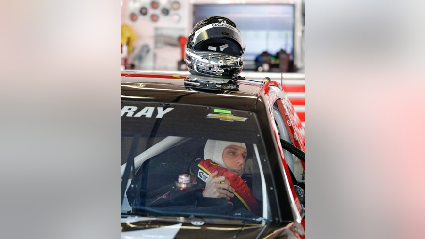 Jamie McMurray gets ready in his car before going out on the track during a practice session for the Daytona 500 NASCAR Sprint Cup Series auto race at Daytona International Speedway, Saturday, Feb. 14, 2015, in Daytona Beach, Fla. (AP Photo/John Raoux)