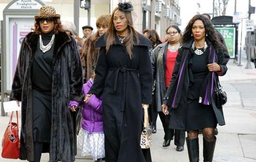 "Ernie Banks' wife Liz, second from right, walks to Chicago's Fourth Presbyterian Church for an official memorial service for Hall of Fame slugger Ernie Banks in Chicago on Saturday, Jan. 31, 2015. Banks died Friday at 83 after a heart attack, according to an attorney representing his family. Known as ""Mr. Cub,"" Banks is remembered as much for his boundless enthusiasm despite playing on mostly losing teams as his 512 home runs and two MVP awards. (AP Photo/Nam Y. Huh)"