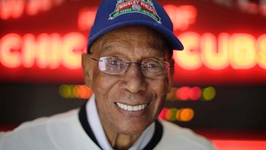 FILE 2014: Chicago Cubs Hall of Fame slugger Ernie Banks smiles after an interview at the Cubs offices in Chicago.
