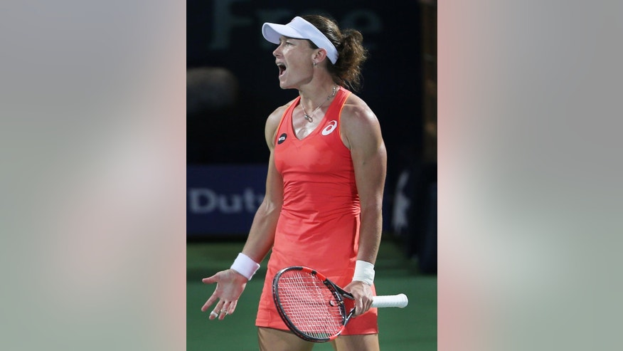 Samantha Stosur of Australia reacts after she missed a ball against Caroline Wozniacki of Denmark during the third day of the Dubai Duty Free Tennis Championships in Dubai, United Arab Emirates, Tuesday, Feb. 17, 2015. (AP Photo/Kamran Jebreili)