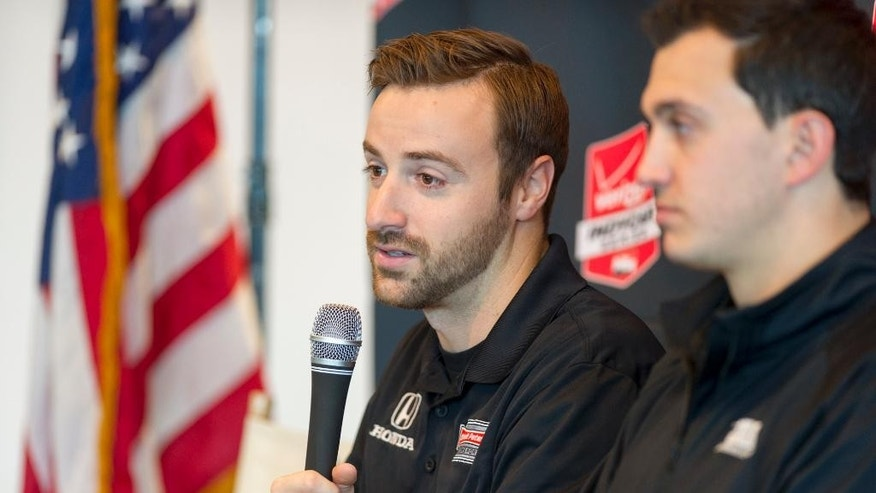 IndyCar driver James Hinchcliffe of Canada talks with reporters during IndyCar Media Day at the Indianapolis Motor Speedway in Indianapolis Tuesday, Feb. 17, 2015. (AP Photo/Doug McSchooler)