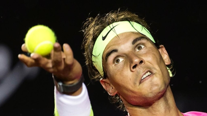 Rafael Nadal of Spain, serves to Thomaz Bellucci of Brazil, during their Rio Open tennis tournament match in Rio de Janeiro, Brazil, Tuesday, Feb. 17, 2015. (AP Photo/Felipe Dana)