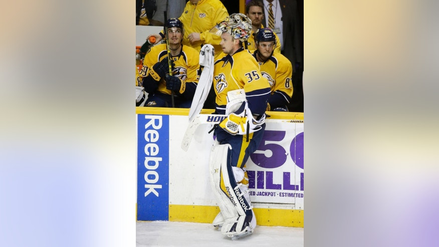 Nashville Predators goalie Pekka Rinne (35), of Finland, takes a break during a timeout in the third period of an NHL hockey game against the San Jose Sharks Tuesday, Feb. 17, 2015, in Nashville, Tenn. Rinne made 42 saves as the Predators won 5-1. (AP Photo/Mark Humphrey)