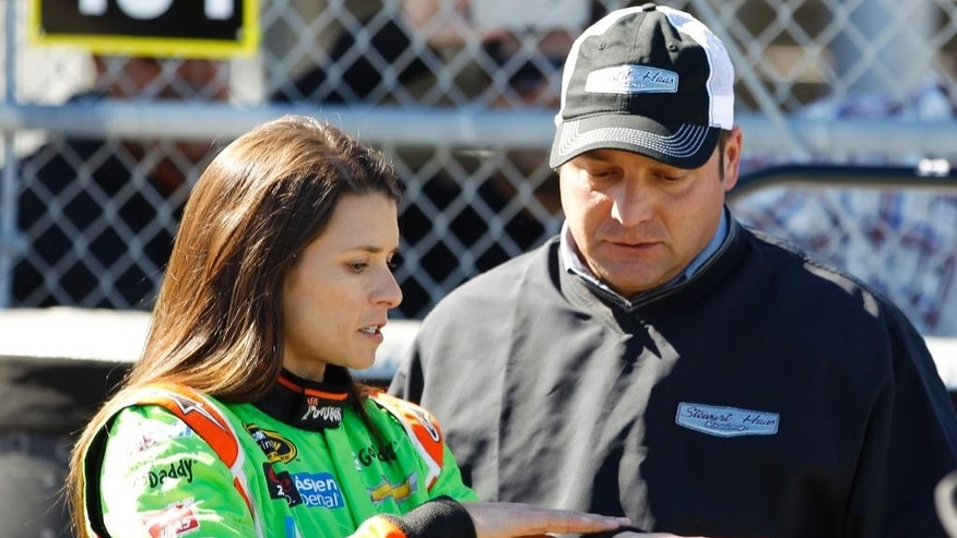 Danica Patrick, left, talks with Greg Zipadelli, competition director at Stewart-Haas Racing, after she was involved in a wreck during a practice session for the Daytona 500 NASCAR Sprint Cup Series auto race at Daytona International Speedway, Wednesday, Feb. 18, 2015, in Daytona Beach, Fla. (AP Photo/Terry Renna)