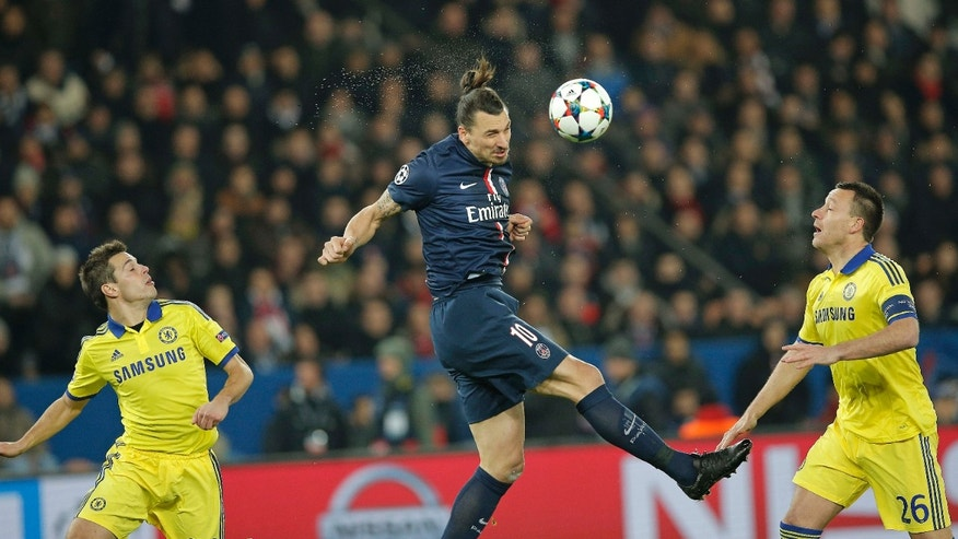 Feb. 17, 2015: PSG's Zlatan Ibrahimovic, centre, heads the ball watched by Chelsea's Cesar Azpilicueta, left, and John Terry during the Champions League round of 16 first leg soccer match between Paris Saint Germain and Chelsea at the Parc des Princes stadium in Paris, France.