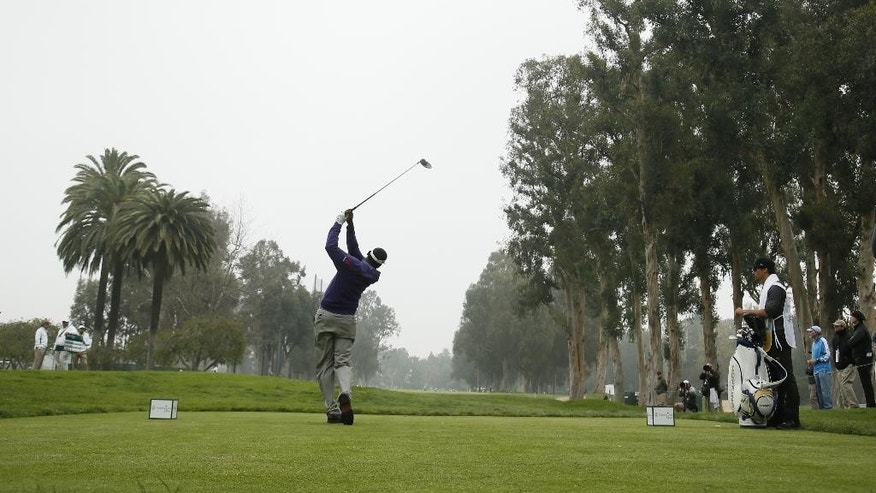 Vijay Singh of Fiji tees off on the 11th hole during the first round of the Northern Trust Open golf tournament at Riviera Country Club in the Pacific Palisades area of Los Angeles on Thursday, Feb. 19, 2015. (AP Photo/Danny Moloshok)