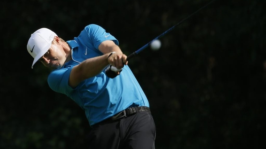 Nick Watney tees off on the 12th hole during the first round of the Northern Trust Open golf tournament at Riviera Country Club in the Pacific Palisades area of Los Angeles on Thursday, Feb. 19, 2015. (AP Photo/Danny Moloshok)