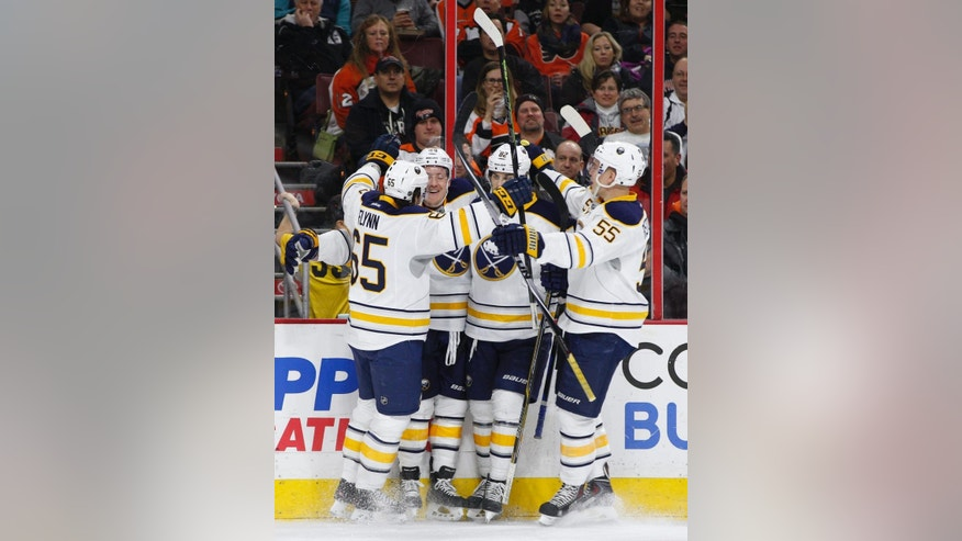 Buffalo Sabres left wing Nicolas Deslauriers , center left, celebrates his goal with teammates; right wing Brian Flynn, left, left wing Marcus Foligno, center right, and defenseman Rasmus Ristolainen, right, of Finland during the first period of an NHL hockey game against the Philadelphia Flyers, Thursday, Feb. 19, 2015, in Philadelphia. (AP Photo/Chris Szagola)