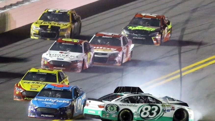 Johnny Sauter (83) spins as Aric Almirola (43) drives past during the first of two qualifying races for the Daytona 500 NASCAR Sprint Cup series auto race at Daytona International Speedway in Daytona Beach, Fla., Thursday, Feb. 19, 2015. (AP Photo/David Graham)