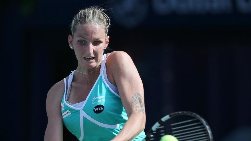 Karolina Pliskova of Czech Republic returns the ball to her fellow country woman Lucie Safarova during a quarter final match of the Dubai Duty Free Tennis Championships in Dubai, United Arab Emirates, Thursday, Feb. 19, 2015. (AP Photo/Kamran Jebreili)