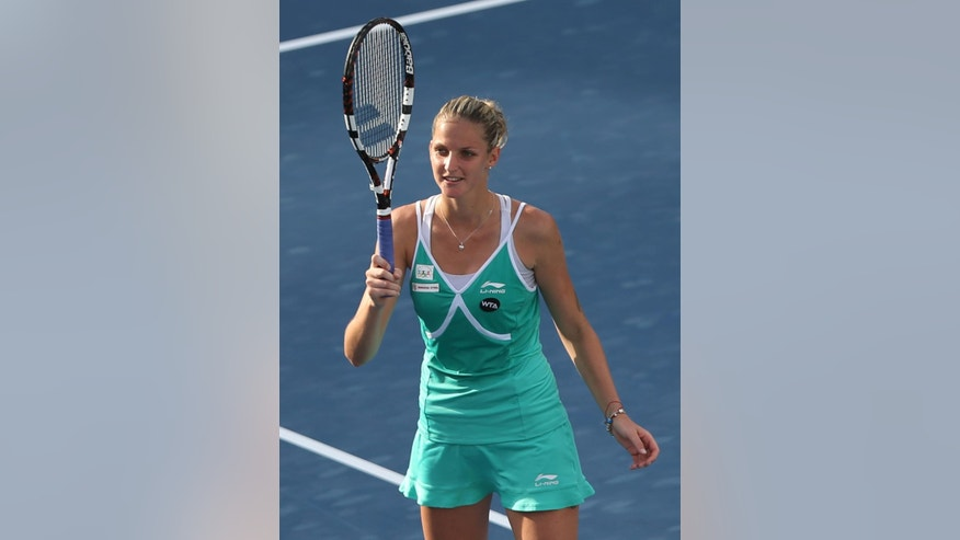 Karolina Pliskova of the Czech Republic celebrates after winning against her compatriot Lucie Safarova during a quarter final match of the Dubai Duty Free Tennis Championships in Dubai, United Arab Emirates, Thursday, Feb. 19, 2015. (AP Photo/Kamran Jebreili)
