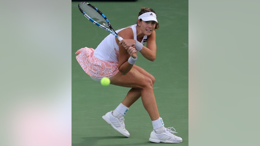 Garbine Muguruza of Spain returns the ball to her compatriot Carla Suarez Navarro during a quarter final match of the Dubai Duty Free Tennis Championships in Dubai, United Arab Emirates, Thursday, Feb. 19, 2015. (AP Photo/Kamran Jebreili)