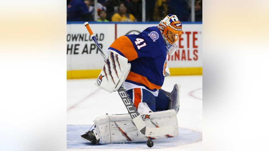 New York Islanders goalie Jaroslav Halak (41) makes a save in the first period of an NHL hockey game against the Nashville Predators in Uniondale, N.Y., Thursday, Feb. 19, 2015. (AP Photo/Kathy Willens)