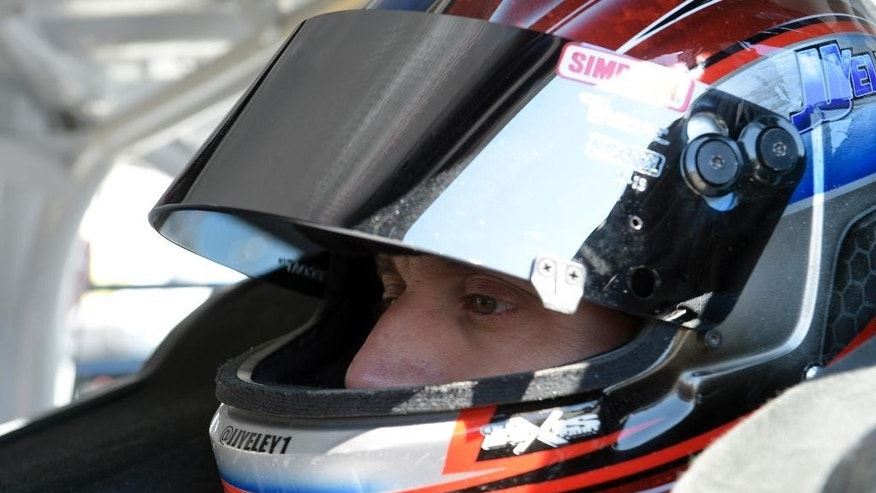 J.J. Yeley sits in his car before practice for the Daytona 500 NASCAR Sprint Cup series auto race at Daytona International Speedway in Daytona Beach, Fla., Thursday, Feb. 19, 2015. (AP Photo/Phelan M. Ebenhack)